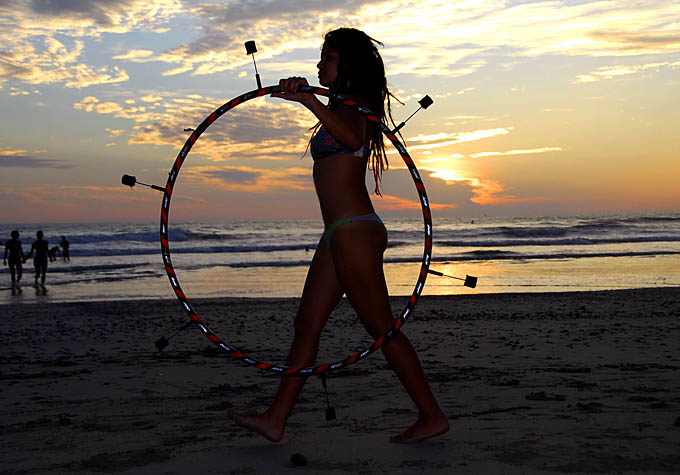 Girl with hula hoop at the beach in Malpais during Manifesto 2009